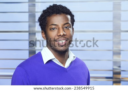 Portrait of a young African-American businessman in the office - stock photo