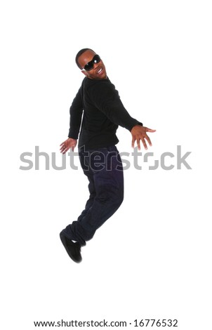 Portrait of a young African American man jumping on white background - stock photo