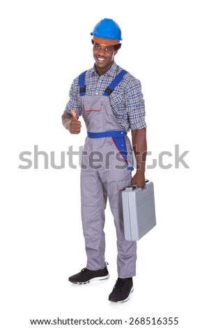 Portrait Of A Young African Craftsman Showing His Thumb Up Over White Background - stock photo