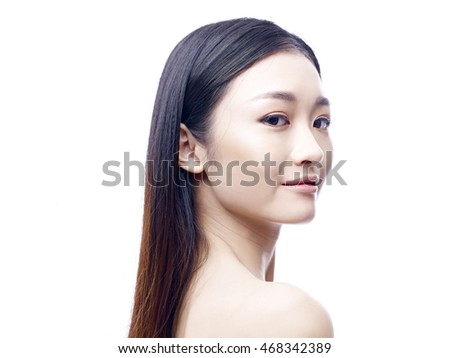 portrait of a young and beautiful asian model, isolated on white background.