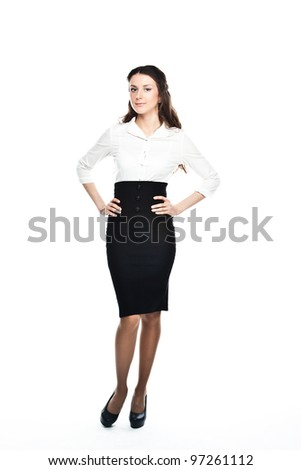 Portrait of a young and beautiful business lady in a white blouse and black skirt