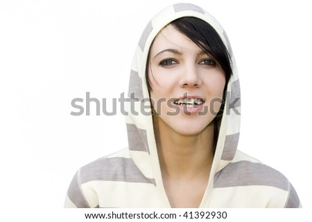 Portrait of a young and beautiful woman with a track suit with hood over her head. - stock photo
