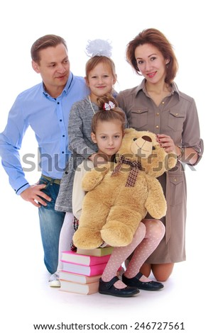 portrait of a young and very positive family.concept childhood education and child development.Isolated on white background - stock photo