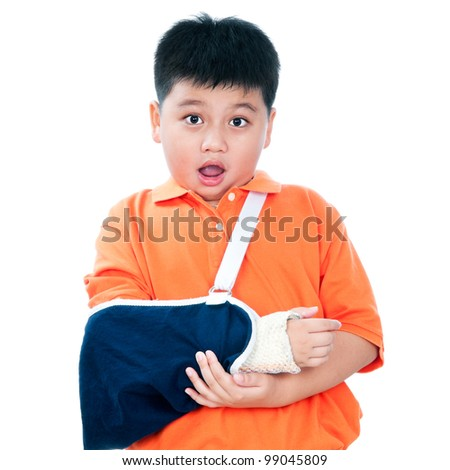 Portrait of a young Asian boy with fractured hand in plaster cast, isolated on white background. - stock photo