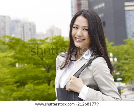 portrait of a young asian businesswoman smiling. - stock photo