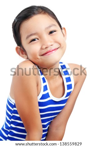 Portrait of a young asian girl with a broad smile. - stock photo