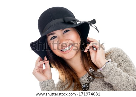 Portrait of a young Asian woman wearing a black hat isolated on a white background - stock photo