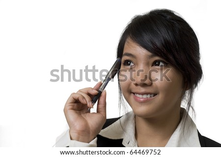 Portrait of a young attractive Asian business woman thinking - stock photo
