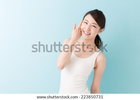 Portrait of a young attractive asian woman - stock photo