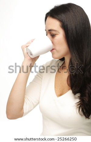 Portrait of a young attractive business woman drinking coffee or tea