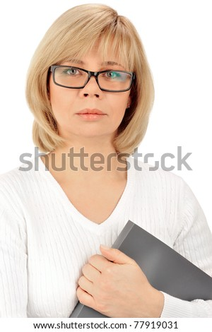 Portrait of a young attractive business woman holding folder with files in her arms and looking at camera. Isolated on white background - stock photo