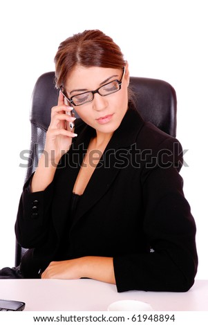 Portrait of a young attractive business woman on the phone