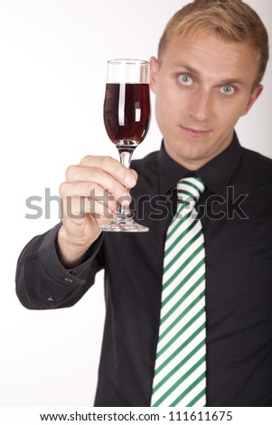 Portrait of a young attractive businessman holding a glass of wine.