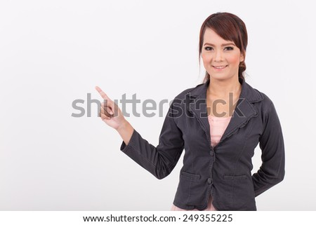 Portrait of a young attractive confident business woman, presentation