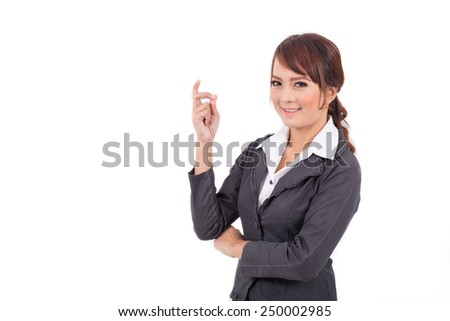 Portrait of a young attractive confident business woman, success, yes, ok, bingo - stock photo