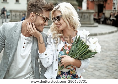 Portrait of a young attractive couple - stock photo