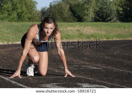 Portrait of a Young, Attractive Female Athlete on Race Track. - stock photo