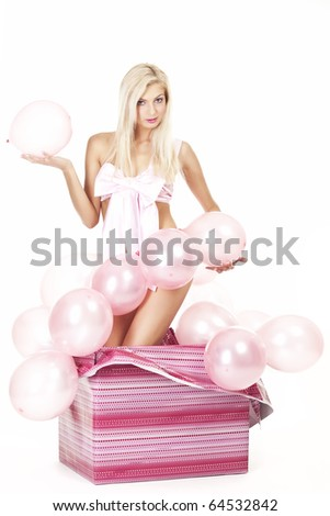 portrait of a young, attractive girl's packaged as a gift with pink balloons - stock photo