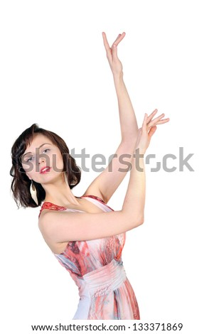 Portrait of a young  attractive girl with the hands raised up on white background. Place for text design. - stock photo