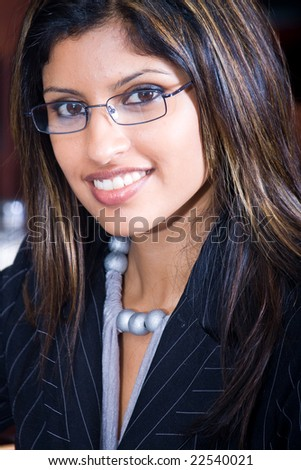 Portrait of a young attractive indian business woman - stock photo