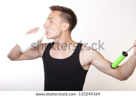 Portrait of a young attractive male drinking milk from bottle. - stock photo