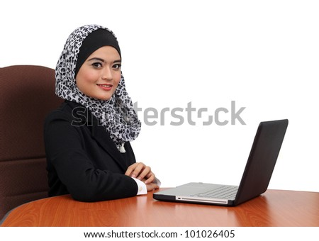 Portrait of a young attractive muslim business woman with laptop - stock photo