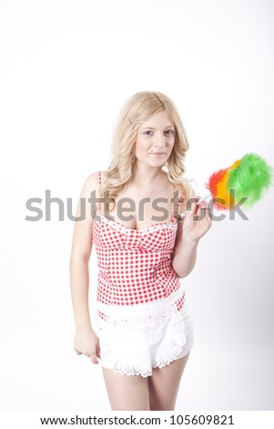 Portrait of a young attractive woman holding a cleaning sweep and smiling. - stock photo
