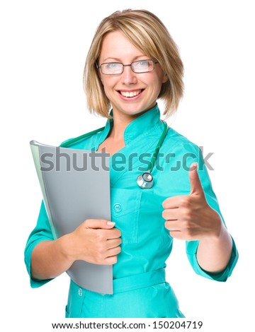 Portrait of a young attractive woman wearing doctor uniform, isolated over white - stock photo