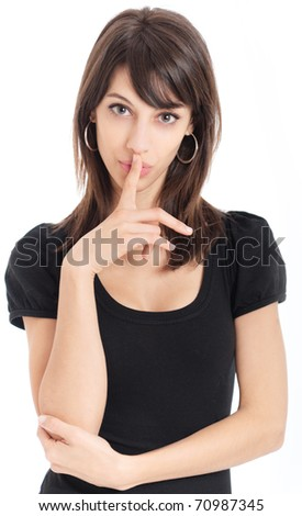 Portrait of a young attractive woman with a hushing gesture - stock photo