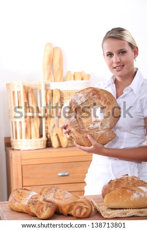 Portrait of a young baker - stock photo