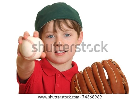 Portrait of a young baseball player showing a baseball - stock photo