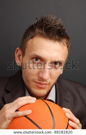 portrait of a young basketball player suited up - stock photo