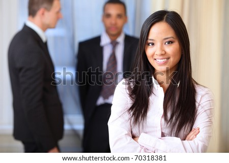 Portrait of a young beautiful asian woman in a business environment