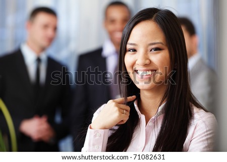 Portrait of a young beautiful asian woman in a business environment - stock photo