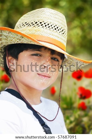 Portrait of a young beautiful boy in the garden - stock photo