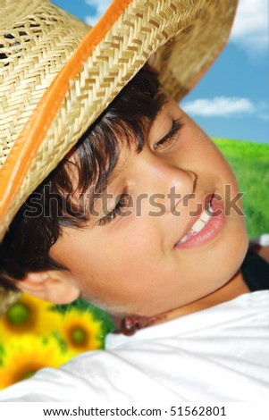 Portrait of a young beautiful boy on the field - stock photo