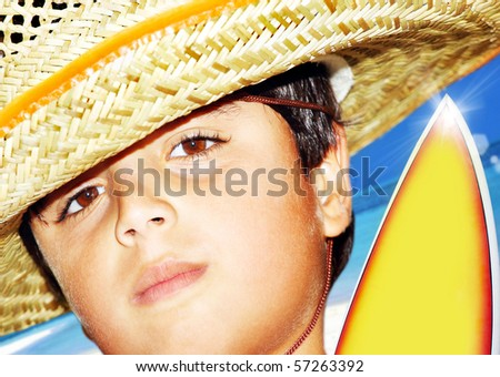 Portrait of a young beautiful boy over blue sky - stock photo