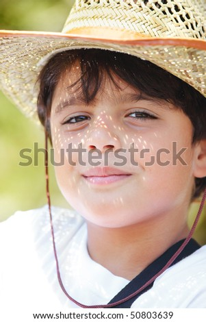 Portrait of a young beautiful boy wearing a hat - stock photo