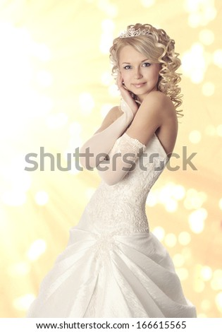 Portrait of a young beautiful bride on light yellow bokeh  background.