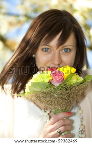 portrait of a young beautiful bride with a bouquet - stock photo