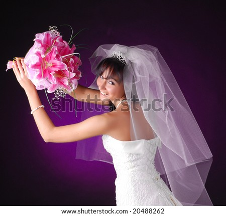 portrait of a young beautiful bride with bouquet of lilys