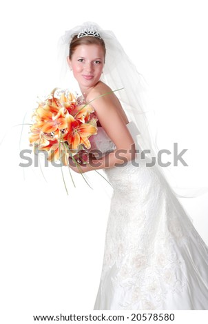 portrait of a young beautiful bride with bouquet of lilys - stock photo