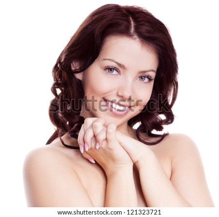 portrait of a young beautiful brunette woman with long curly hair, isolated against white background - stock photo