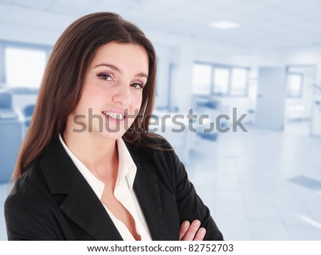 Portrait of a young beautiful businesswoman. Blue background. - stock photo