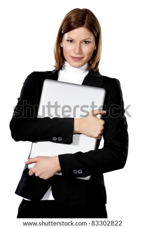 Portrait of a young beautiful businesswoman holding laptop in her arms - stock photo