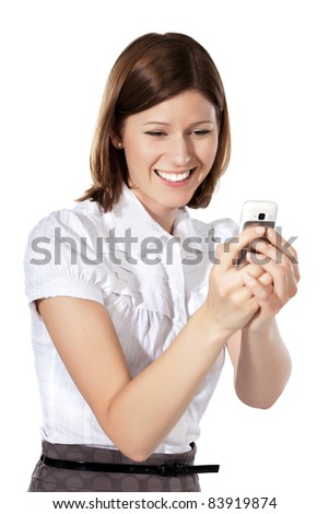 Portrait of a young beautiful businesswoman laughing at something funny in her phone - stock photo