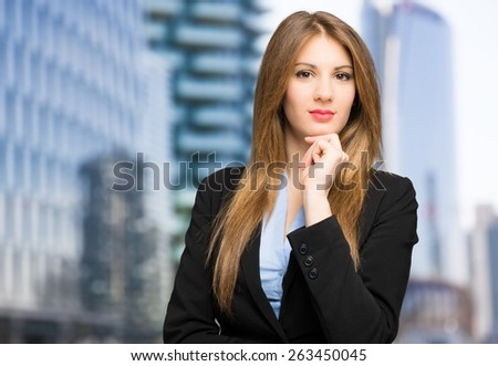 Portrait of a young beautiful businesswoman outdoor - stock photo