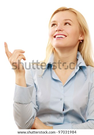 Portrait of a young beautiful businesswoman pointing up - stock photo