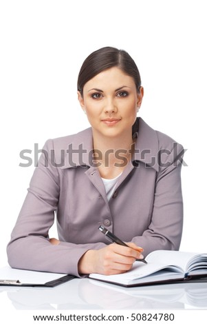 Portrait of a young beautiful businesswoman writing in the diary over white. - stock photo