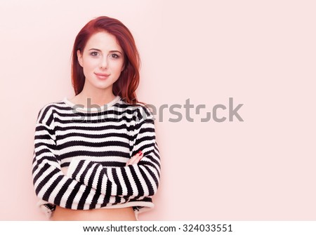 Portrait of a young beautiful caucasian woman on pink background - stock photo